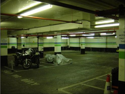 Motorbike legally parked and found on the floor inside Queensway car park